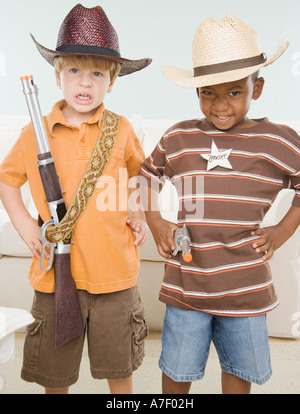 Two young boys dressed as cowboys - Stock Photo