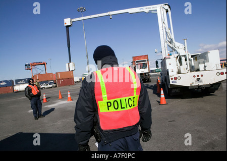 Customs and Border Protection officers watch operations of a VACIS at Port of Newark Container Terminal in Newark - Stock Photo