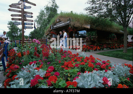 USA Alaska Flower display at Visitors Information Centers log cabin in downtown Anchorage - Stock Photo