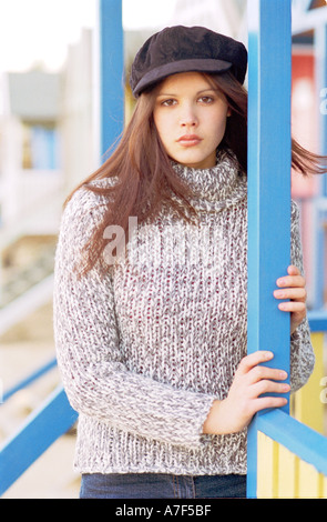Young woman standing in beach hut and looking at camera - Stock Photo