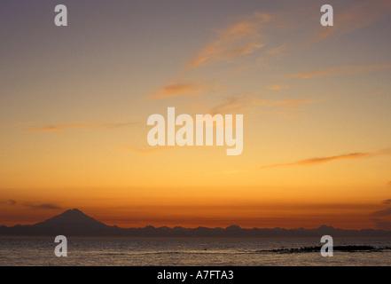 US, AK, Sunset from Deep Creek SRA in Ninilchik, Redoubt Volcano, Across Cook Inlet.  Mt. Redoubt - Stock Photo