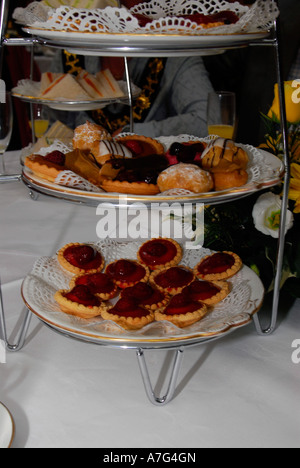 Sandwiches and cakes on table at a Tea Dance for the elderly Hammersmith Town Hall London - Stock Photo
