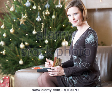A woman writing Christmas cards - Stock Photo