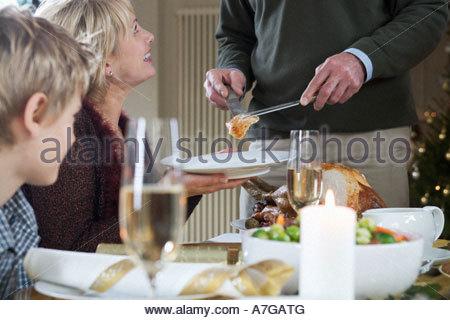 Dishing up the Christmas turkey - Stock Photo