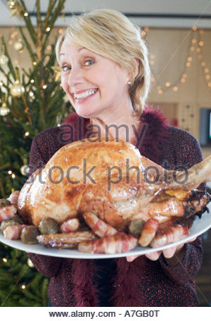 A grandmother with the Christmas turkey - Stock Photo
