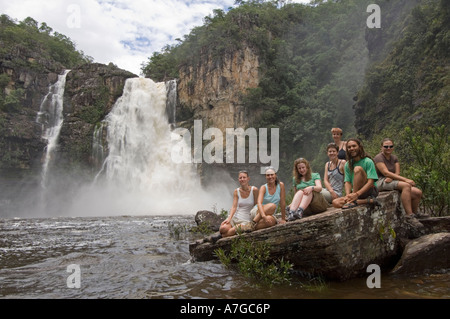 A group of european female tourists and guide at the 120 meter waterfall in The Chapada dos Veadeiros National Park - Stock Photo