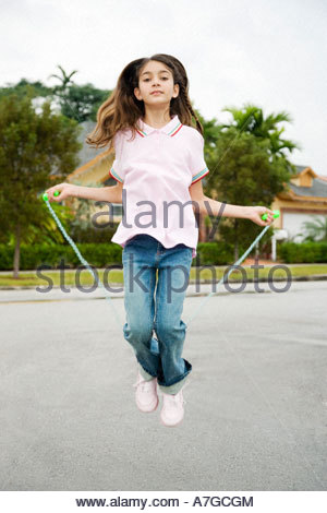 A young girl skipping - Stock Photo