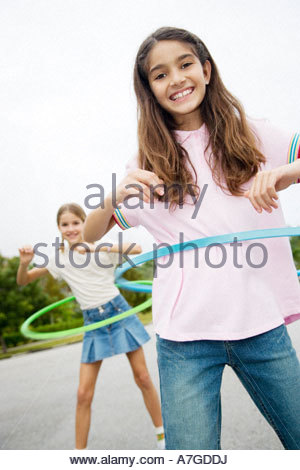 Two young girls with hoops - Stock Photo