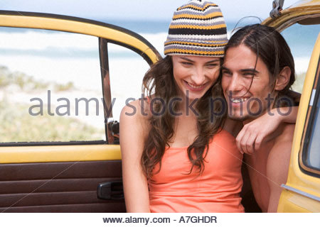 A young couple on a beach - Stock Photo
