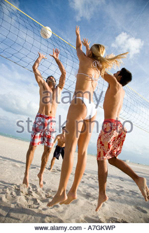 A game of beach volleyball - Stock Photo