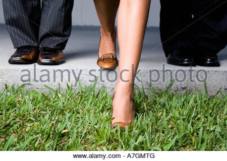 Close up of three business colleagues' feet - Stock Photo