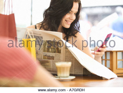 A young woman having a break from shopping - Stock Photo