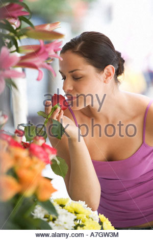 A young woman looking at a flower stall - Stock Photo