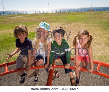 Four children on a playground - Stock Photo