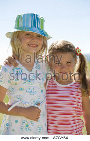Portrait of two young girls - Stock Photo