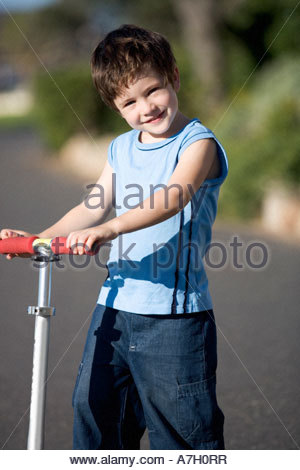 A young boy on a scooter - Stock Photo