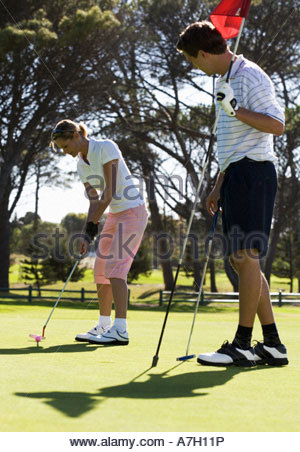 Couple playing golf - Stock Photo