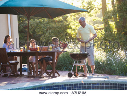 Family barbeque on the patio - Stock Photo