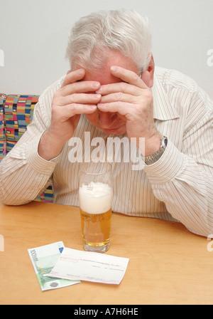 drinks beer - Stock Photo