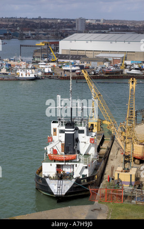 unloading a ship in the River Itchen and Southampton harbour - Stock Photo