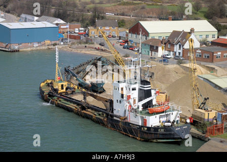 unloading sand from a ship in the River Itchen and Southampton harbour - Stock Photo