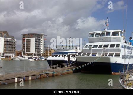 two twin hulled catarmaran passenger vessels in the Ocean Village Marina Southampton - Stock Photo