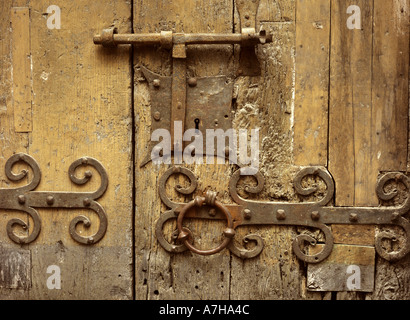 Iron lock on wooden door of the 13th Century church of St Jacques at Villefranche de Conflent in the Pyrenees Orientales, - Stock Photo