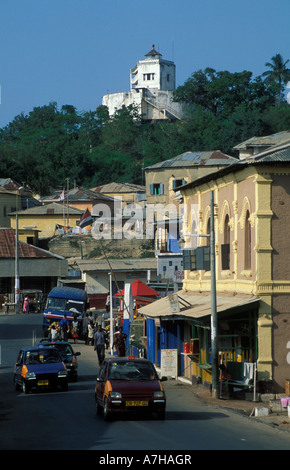 street scene in Cape Coast with Fort William on the hill, once a lookout post for Cape Coast Castle, Ghana - Stock Photo
