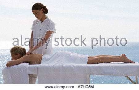 A young woman having a massage - Stock Photo