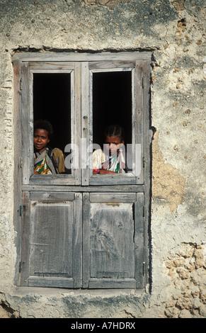 Swahili girls at a window, Siyu town, Pate island, Lamu Archipelago, Kenya - Stock Photo
