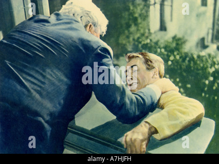 REAR WINDOW 1954 Paramount film with James Stewart at right, directed by Alfred Hitchcock - Stock Photo