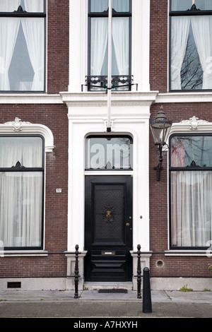 Front of old house in Dordrecht, Holland - Stock Photo