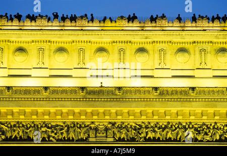 Arc de triomphe, Paris illuminated in the evening - Stock Photo