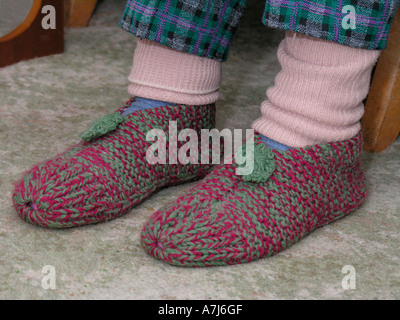 Elderly Woman Wearing Leg Warmers And Knitted Slippers To ...
