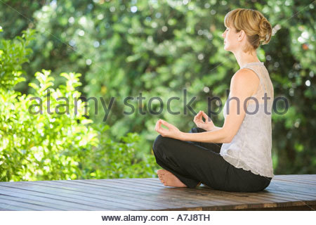 A young woman meditating - Stock Photo
