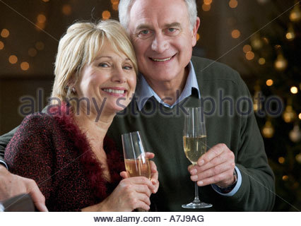 A senior couple drinking champagne - Stock Photo