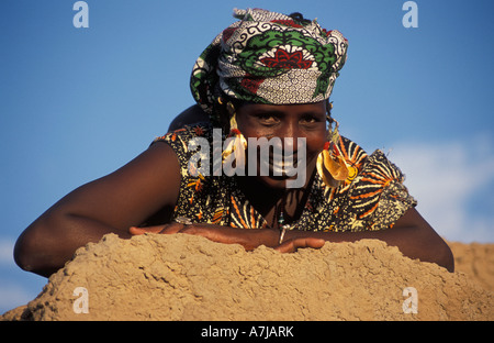Peul or Fula woman with characteristic mouth tattoo wearing traditional golden earrings, Djenné, Mali - Stock Photo