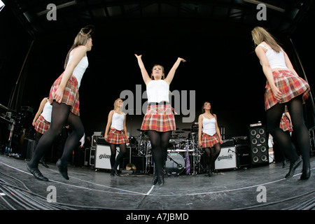 Fisheye shot of Highland Ulster Scots female dancers on stage during concert for St Patricks Day Belfast Northern - Stock Photo