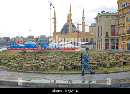 LEBANON BEIRUT Modern downtown Beirut with tent city of protesters and armed soldier patrolling new mosque under - Stock Photo