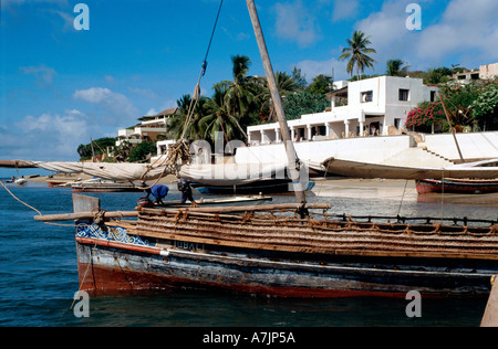 Peponi Hotel View from Boat with Dhau in Foreground Shela Lamu Kenia East Africa - Stock Photo