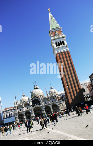 World famous Venice landmarks St Marks Square Basilica and Campanile Bell Tower with perfect blue sky Italy Europe - Stock Photo
