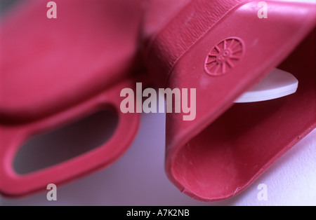 pink rubber hot water bottle - Stock Photo