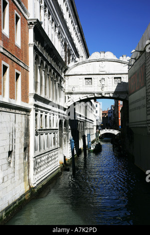 World famous architecture of the Bridge of Sighs Ponte dei Sospiri spanning a tyical Venice waterway near Grand - Stock Photo