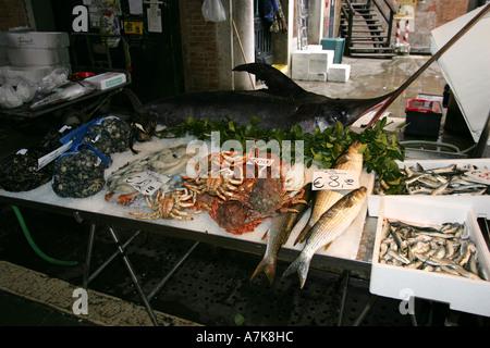 World famous fish market Prescaria near the Rialto Bridge, central Venice Italy Europe popular with tourists