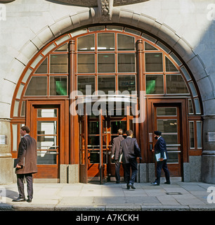 Businessmen outside the entrance of Goldman Sachs Office headquarters  in Fleet Street City of London England UK - Stock Photo