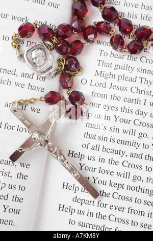 Rosary beads on a book of psalms - Stock Photo