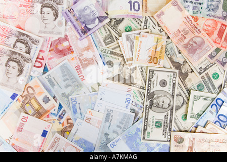 Various currencies, including US dollars, euros, pounds sterling, and Indian rupees. - Stock Photo