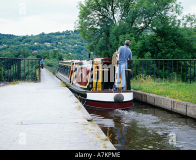 Llangollen Denbighshire North Wales UK June Maroon and yellow narrowboat on the Pontcysyllte Aqueduct - Stock Photo