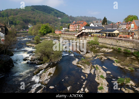 The river Dee flows through Llangollen in Dwyfed in North Wales with the heritage railway station on the banks of - Stock Photo