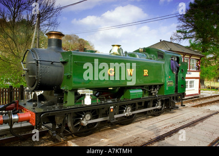 A steam tank engine pictured station on the Llangollen heritage railway with passenger coaches at Glyndyfrdwy Station. - Stock Photo
